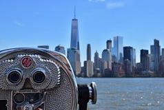 Manhattan Skyline - Binocular Viewer. Manhattan skyline and binocular viewer showing viewer in sharp focus and skyline buildings slightly out of focus Stock Photography