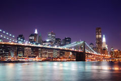 Manhattan skyline and Brooklyn Bridge Stock Photos