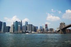 Manhattan Skyline and Brooklyn Bridge Stock Photo