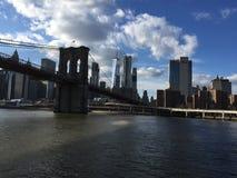 Manhattan skyline Brooklyn bridge. Manhattan skyline from boat Stock Image