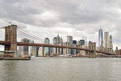 Manhattan skyline with Brooklyn Bridge. Stock Image