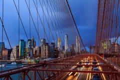 Manhattan skyline from the Brooklyn bridge at dusk Stock Photos