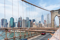 Manhattan Skyline through Brooklyn Bridge, New York Stock Photo