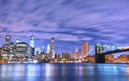 Manhattan skyline and Brooklyn Bridge at night. Stock Images