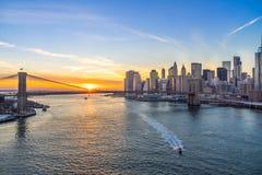 Manhattan skyline and brooklyn bridge. View of Brooklyn Bridge and Manhattan skyline at sunset Royalty Free Stock Image