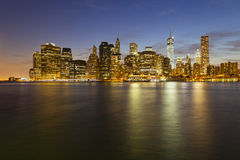 Manhattan Skyline From Brooklyn At Night. The Manhattan skyline in New York City at night including the new One World Trade Center Royalty Free Stock Photo