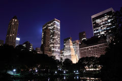 Manhattan Skyline and Central Park at Night Stock Images