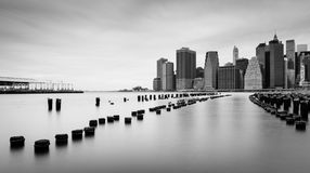 Manhattan skyline at cloudy day, black and white photo, New York Royalty Free Stock Photos