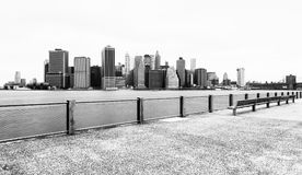 Manhattan skyline in cloudy day, black and white, view from Brooklyn Bridge Park, Pier 5, New York, USA Royalty Free Stock Photo