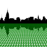 Manhattan skyline with dollars Stock Image