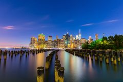 Manhattan Skyline after dusk, New York City. Lower Manhattan skyline after dusk from Brooklyn Bridge park, Dumbo, Brooklyn, New York city royalty free stock photos