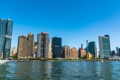 Manhattan skyline from East River, NYC. Manhattan,New York City,USA - June 30, 2018 : Skyscrapers of Manhattan view from the East River stock photography
