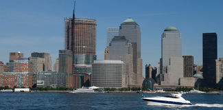 Manhattan skyline New York. Skyline of Manhattan in New York city, U.S.A. Boat sailing in foreground Royalty Free Stock Photo