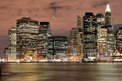 Manhattan skyline At Nigh Stock Photo