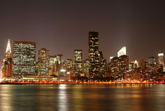 Manhattan skyline at Night royalty free stock photography