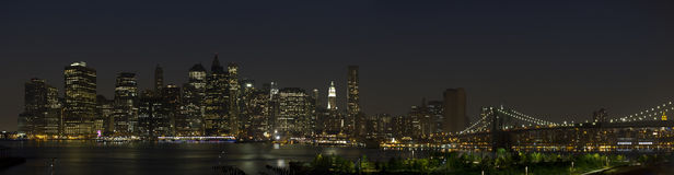 Manhattan skyline night Stock Images