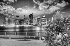 Manhattan skyline at night as seen from Brooklyn Bridge Park - I Stock Images