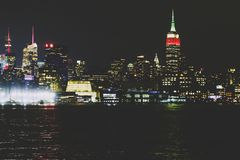 Manhattan skyline by night as seen from Hoboken, New Jersey. HOBOKEN, NJ - September 16th, 2017: Manhattan skyline by night as seen from Hoboken, New Jersey royalty free stock photo