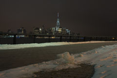 Manhattan skyline at night, New York City. View from pavement. Winter  Stock Photo