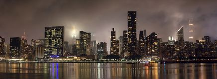 Manhattan skyline at night with reflections, NYC, USA. royalty free stock image