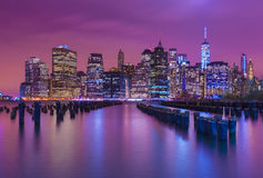 Manhattan skyline at night with varicolored reflections in the w Royalty Free Stock Photo