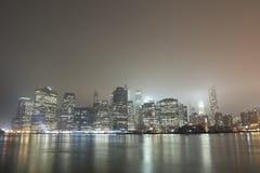 Manhattan skyline at night. View of New York city, Manhattan skyline at night with fog Royalty Free Stock Photo