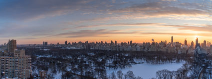 Manhattan skyline. Over looking Central Park in Manhattan with high rise alone the fifth Ave and beyond Royalty Free Stock Image