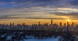 Manhattan skyline. Over looking Central Park in Manhattan with high rise alone the fifth Ave and beyond Royalty Free Stock Photo