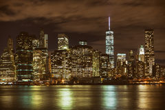 Manhattan skyline reflections at night in New York. Iconic view of the New York skyline Stock Images
