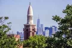 Manhattan Skyline. St. Michael's Roman Catholic Church tower in Sunset Park, Brooklyn looming over lower Manhattan skyline Royalty Free Stock Photos