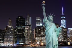 Manhattan Skyline and The Statue of Liberty at Night Royalty Free Stock Photography