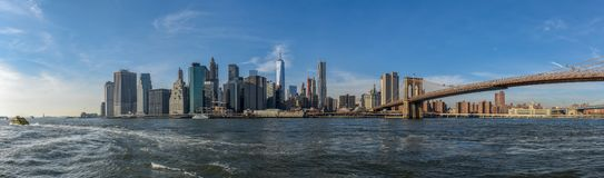 Manhattan skyline on a sunny day with Brooklyn Bridge in view royalty free stock photos