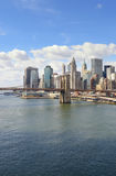 Manhattan skyline at sunny day. Lower Manhattan with Brooklyn Bridge at sunny day Stock Images