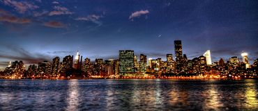 Manhattan skyline at sunset. Panoramic view of the Manhattan, New York skyline at dusk Royalty Free Stock Image