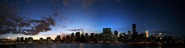 Manhattan skyline at sunset. Panorama of the Manhattan skyline at sunset royalty free stock photos