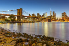 Manhattan skyline at sunset with Brooklyn Bridge Stock Photography
