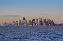 Manhattan Skyline at Sunset. The Skyline of Manhattan seen from the Staten Island Ferry at sunset Royalty Free Stock Photo