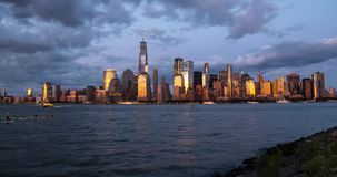 Manhattan skyline time lapse at sunset day to night transition. New York City view timelapse. Manhattan skyline time lapse at sunset day to night transition. New stock video