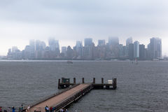 Manhattan Skyline Under the Fog Stock Images