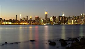 Manhattan skyline view from Brooklyn after sunset Stock Images