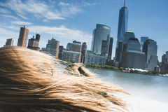 Manhattan skyline view from a high speed boat, over blonde woman Royalty Free Stock Photos