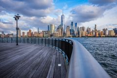 Manhattan skyline view from Jersey City waterfront. Pontoon royalty free stock photography