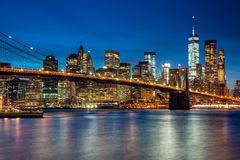 Manhattan with skyscrapers and  Brooklin Bridge by evening, New Stock Image