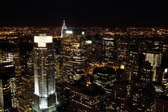 Manhattan skyscrapers at night Stock Photos