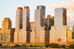Manhattan skyscrapers at sunset Stock Images