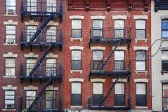 Manhattan, stary budynek z pożarniczymi ucieczkami Obraz Royalty Free