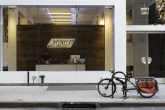 Manhattan  Storefront Office. New York, NY USA -- Aug 3, 2016  A storefront office with a glass exterior wall and a bycycle parked outside. Editorial Use Only Royalty Free Stock Photos