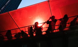 Times Square in New York City. Manhattan street scene. Silhouettes of people on the red staircase in Times Square in New York City stock photography