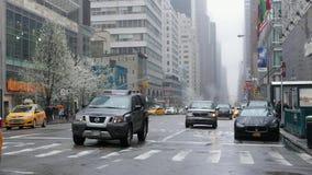 Manhattan street traffic on a rainy day. A rainy day in Manhattan New York stock video footage
