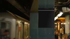 Manhattan Subway Train Approaches Platform Blank Sign. A subway train approaches a platform in Manhattan. Blank sign on pole for easy location customization stock video footage